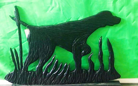 wood carving of a dog, by Vancouver Island wood carver West Coast Wood Creations