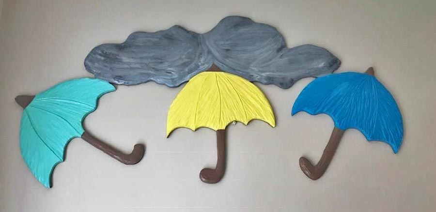 wood carved umbrella with rain cloud, by Vancouver Island wood carver West Coast Wood Creations