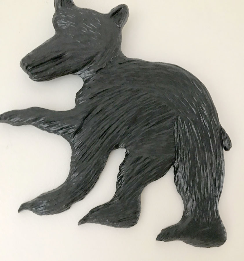 wood carving of bear cub made in Nanaimo Canada by West Coast Wood Creations carver