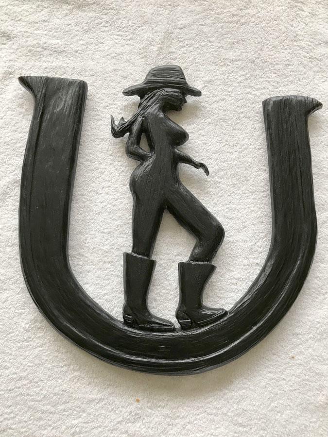 cowgirl with horseshoe wood carving made in Nanaimo by West Coast Wood Creations