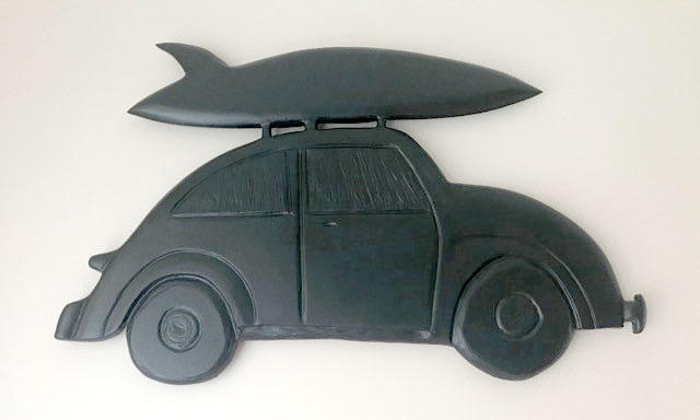 wood carving of VW bug car with surfboard on top, by Canadian wood carver Kim Reavley