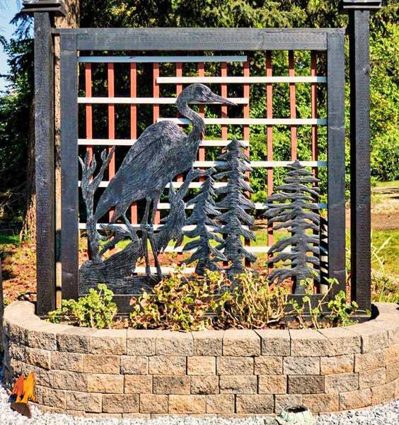 garden privacy fence of heron on trees by Vancouver Island wood carver West Coast Wood Creations