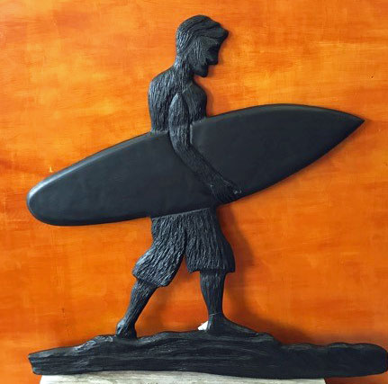 carving of surfer made on Vancouver Island by woodworker West Coast Wood Creations