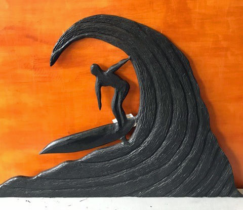 wooden carved surfer on wave by Vancouver Island wood carver Kim Reavley