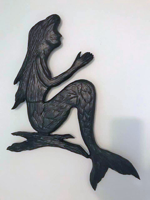 wood carving of mermaid on a rock, made in Nanaimo, Vancouver Island by Canadian wood carver Kim Reavley