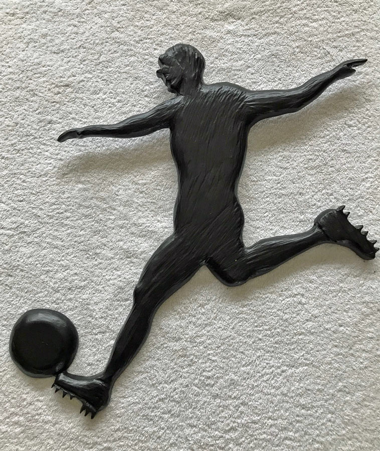 wood carving of soccer player, made in Canada by West Coast Wood Creations