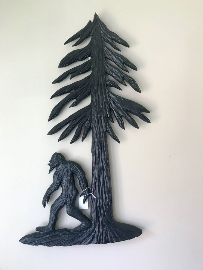 Wood Carving of Vancouver Island sasquatch Big Foot with fir tree, carved by Nanaimo Artist Kim Reavley