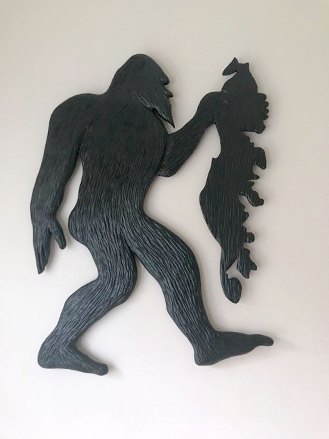Sasquatch carrying Vancouver Island wood carving by Canadian wood carver Kim Reavley